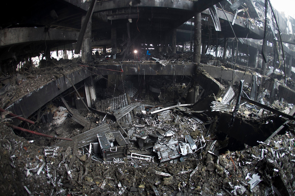 Description of . In this photo taken on Wednesday, Jan.  21, 2015, the destroyed airport in Donetsk, eastern Ukraine is pictured. Battles for control over the airport on the northern edge of the main separatist stronghold of Donetsk intensified over the week with rebels taking control over the terminal, although fighting is continuing in nearby settlements. The airport, which was a major showcase of the Euro 2012 Championship hosted by Ukraine, has been reduced to a hulking wreck by months of intense fighting. (AP Photo/Igor Ivanov)