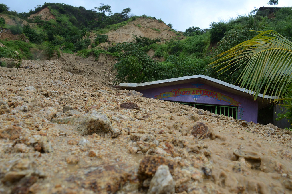Description of . A small chapel is engulfed in rock and mud from a landslide triggered by heavy rains brought on by Tropical Storm Manuel on the outskirts of Acapulco, Mexico, Monday, Sept. 16, 2013. Tropical Storm Ingrid and remnants of Tropical Storm Manuel drenched Mexico's Gulf and Pacific coasts, flooding towns and cities in a national emergency that federal authorities say has caused at least 34 deaths. (AP Photo/Bernandino Hernandez)