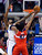Washington Wizards center Nene, right, of Brazil, puts up a shot as Los Angeles Clippers center DeAndre Jordan defends during the first half of their NBA basketball game, Saturday, Jan. 19, 2013, in Los Angeles.  (AP Photo/Mark J. Terrill)