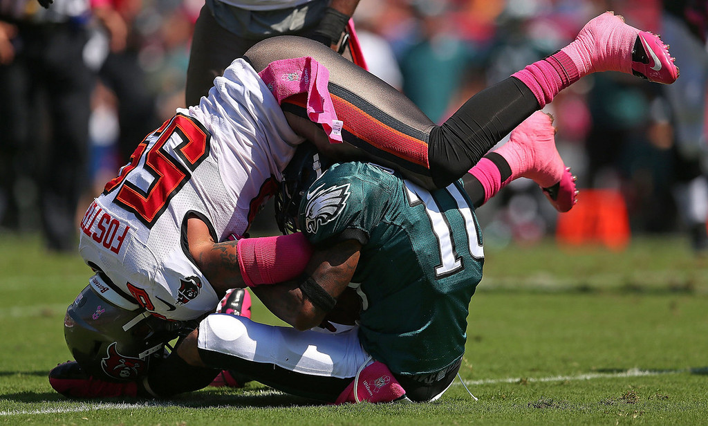 Description of . DeSean Jackson #10 of the Philadelphia Eagles is tackled by Mason Foster #59 of the Tampa Bay Buccaneers during a game  at Raymond James Stadium on October 13, 2013 in Tampa, Florida.  (Photo by Mike Ehrmann/Getty Images)