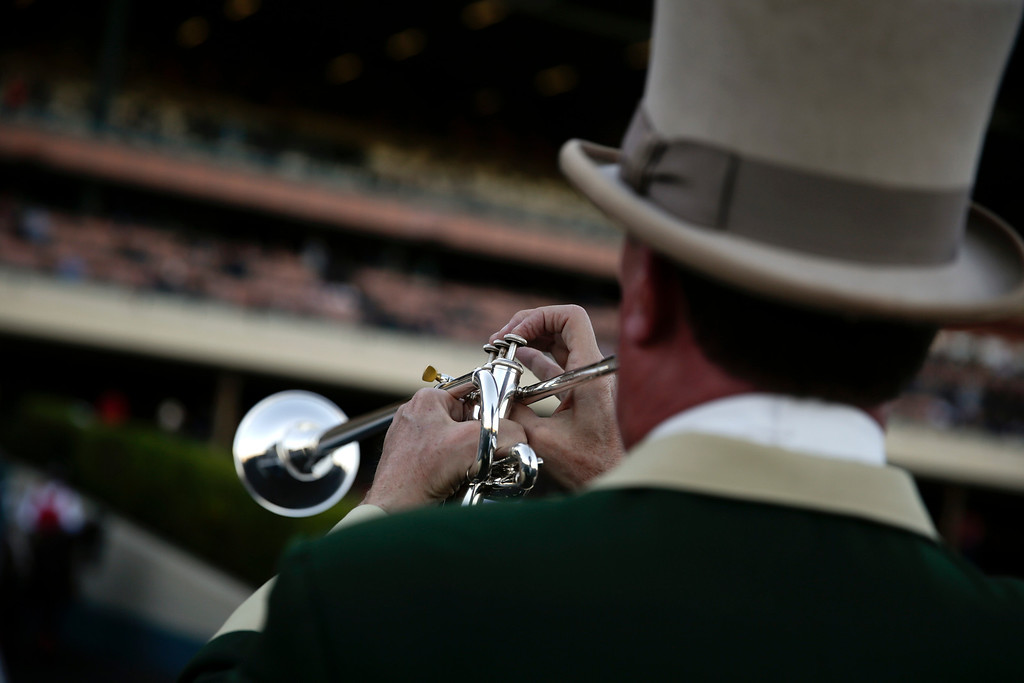 . Hollywood Park bugler Jay Cohen, who has been working at the track since 1988, plays the call to the post prior to a race at Betfair Hollywood Park on Saturday, Dec. 14, 2013, in Inglewood, Calif. After 75 years of thoroughbred racing, Betfair Hollywood Park is closing for good. The 260-acre track that hosted Seabiscuit and the first Breeders\' Cup in 1984 will be turned into a housing and retail development starting next year. (AP Photo/Jae C. Hong)