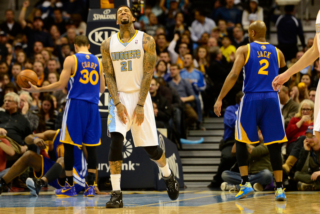 Description of . Denver Nuggets shooting guard Wilson Chandler (21) reacts to being called for an offensive foul against the Golden State Warriors during the second half of the Nuggets' 116-105 win at the Pepsi Center on Sunday, January 13, 2013. AAron Ontiveroz, The Denver Post