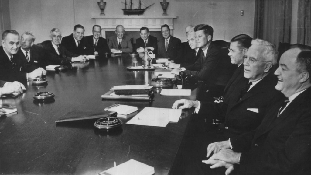Description of . Kennedy meets  with congressional leaders and members of his cabinet on the eve of the opening of the 88th Congress. From left: Vice President Lyndon Johnson, Senate Minority Leader Everett Dirksen, R-Ill., Sen. Leverett Saltonstall, R-Mass., Rep. Thomas Morgan, D-Pa., Sen. Thomas Kuchel, R-Calif., Rep. Leslie Arends, R-Ill., Rep. Carl Albert, D-Okla., Rep. Hale Boggs, D-La., Rep. Carl Vinson, D-Ga., partially hidden, Secretary of State Dean Rusk, the President, Defense Secretary Robert McNamara, John McCone, director of the Central Intelligence Agency, and Sen. Hubert Humphrey, D-Minn.  Denver Post file
