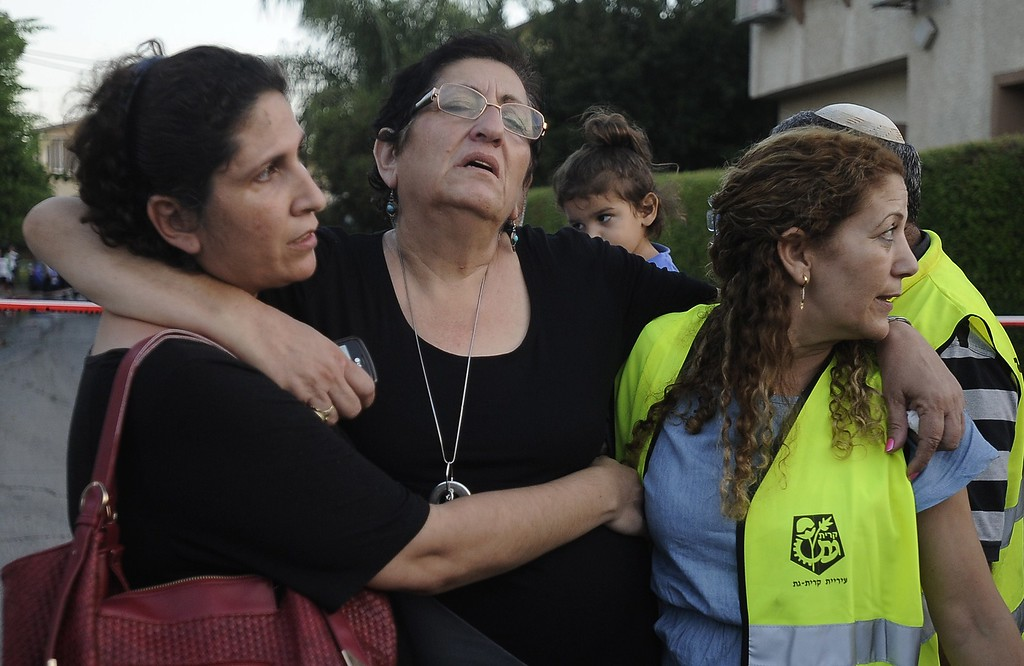 Description of . A woman reacts after a rocket launched by Palestinian militants in the Gaza Strip fell on the Israeli town of Kiryat Gat on July 31, 2014. Israel began its military offensive in Gaza on July 8 with the aim of stamping out persistent militant rocket fire on southern Israel, but expanded the operation by sending in ground troops on July 17 to destroy a sophisticated network of tunnels used by militants. AFP PHOTO/DAVID BUIMOVITCH/AFP/Getty Images