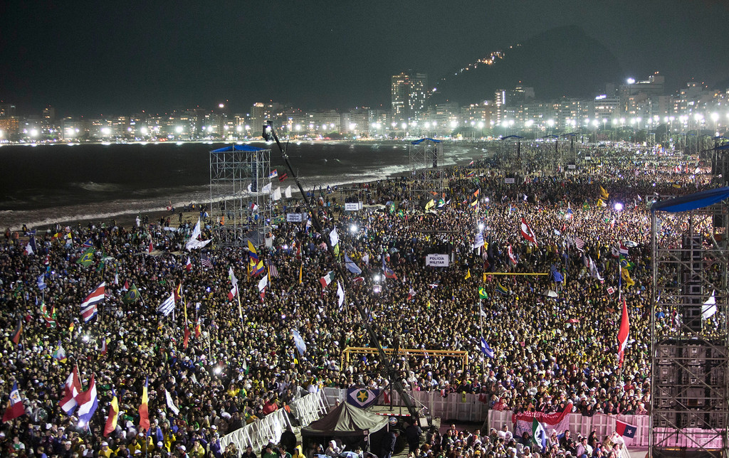 Description of . Hundreds of thousands crowd the Copacabana beachfront during the World Youth Day Welcome Feast in Rio de Janeiro, Thursday, July 25, 2013.  Pope Francis addressed the young pilgrims from 175 nations gathered on the famous beach. Francis is on the fourth day of his trip to Brazil. (AP Photo/Domenico Stinellis)
