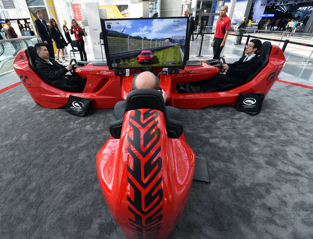 Description of . Media members try out the Toyota Driving Experience during the first press preview day at the 2014 New York International Auto Show April16, 2014 at the Jacob Javits Center in New York. The show opens to the public on April 18 and runs through the 27th.  AFP PHOTO / Timothy A. Clary/AFP/Getty Images
