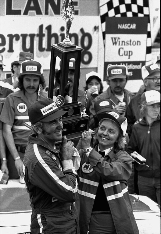 Description of . Bobby Allison and his wife, Judy, hold aloft the Daytona 500 race trophy in victory lane February 19, 1978 after Allison, of Hueytown, Ala. won the race.  (AP Photo)