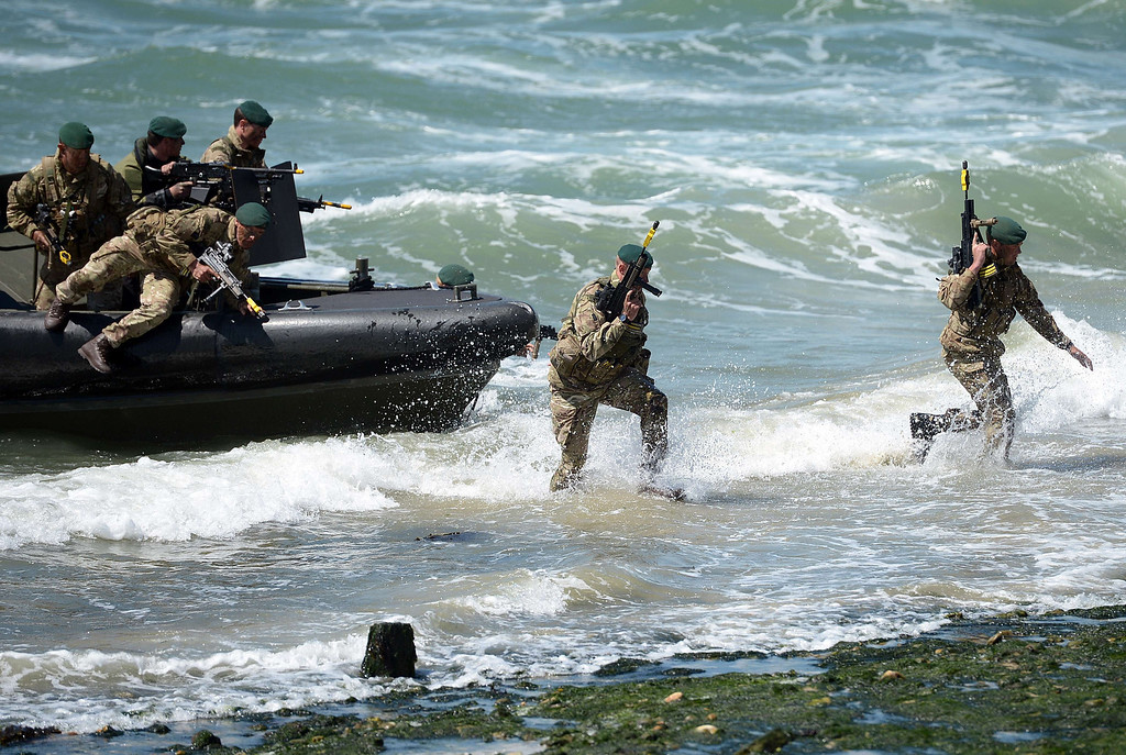 Description of . British Royal Marine Commandos demonstrate a beach landing during D-Day commemorations in Portsmouth in southern England on June 5, 2014. Several hundred surviving veterans of the 1944 D-Day landings are commemorating the 70th anniversary of the mission on both sides of the English channel.  AFP PHOTO / CARL COURT/AFP/Getty Images