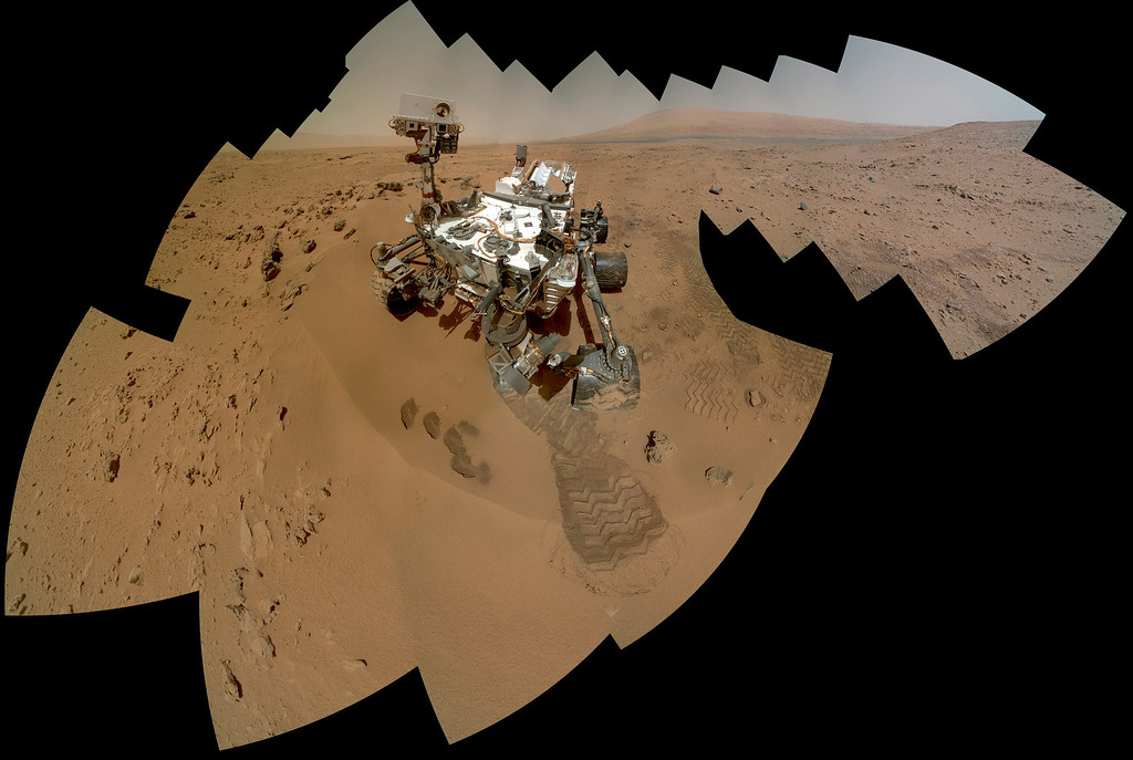 Description of . FILE - This image provided by NASA shows a color self-portrait of the Mars rover Curiosity. The rover used the Mars Hand Lens Imager (MAHLI) to capture dozens of high-resolution images to be combined into self-portrait images of the rover. (AP Photo/NASA/JPL-Caltech/MSSS, File)