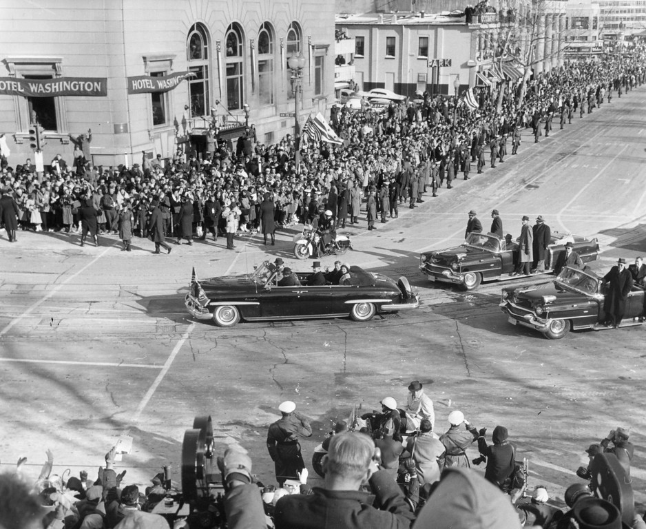 Description of . Kennedy and the first lady are driven through the crowded streets on the day of his inauguration in January 1961.  Photo by Keystone/Getty Images