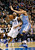 Dallas Mavericks guard Vince Carter (L) drives against Denver Nuggets center JaVale McGee during the first half of their NBA basketball game in Dallas, Texas, December 28, 2012.  REUTERS/Mike Stone