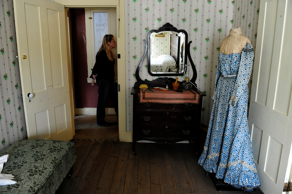 Description of . GOLDEN, CO - MAY 14: A visitor walks by one of the rooms at the Astor House Museum on May 14, 2014, in Golden, Colorado. The house originally opened in 1867 as a hotel for state legislators, but was later turned into a boarding house and operated as such until the 1970s. The museum will soon undergo structural renovations to fix degrading elements of its foundation. While the museum is closed to complete these renovations, exhibits and artifacts will be updated to better reflect its history as a boarding house. (Photo by Anya Semenoff/The Denver Post)