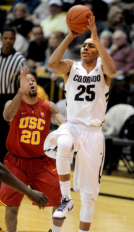 Description of . Spencer Dinwiddie of CU puts up a shot on J.T. Terrell of USC during the second half of the January 10, 2013 game in Boulder.    Cliff Grassmick/Daily Camera