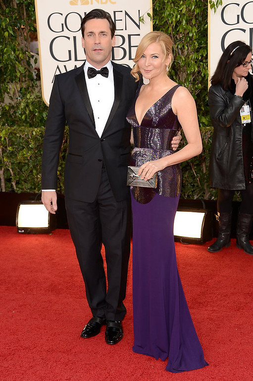 Description of . Actor Jon Hamm (L) and actress-filmmaker Jennifer Westfeldt arrive at the 70th Annual Golden Globe Awards held at The Beverly Hilton Hotel on January 13, 2013 in Beverly Hills, California.  (Photo by Jason Merritt/Getty Images)
