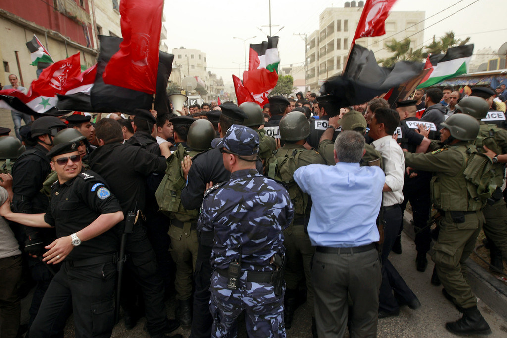 Description of . Police block Palestinian protesters during a rally against U.S. President Barack Obama, in the West Bank city of Bethlehem, Friday, March 22, 2013. (AP Photo/Majdi Mohammed)