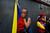 A woman holding a Venezuelan flag cries as she watches the coffin containing the body of the late President Hugo Chavez be taken from the hospital, where he died on Tuesday, to a military academy in Caracas, Venezuela, Wednesday, March 6, 2013. (AP Photo/Rodrigo Abd)