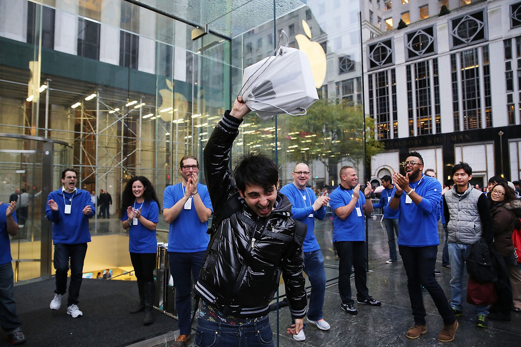 Description of . The first customer in line, Rami Shamis, holds up his new iPad Air at the Apple Store on November 1, 2013 in New York City. The new iPad, which will also come in a mini version, is 20% thinner and 28% lighter than the current fourth-generation iPad. It has the same 9.7-inch screen as previous iPads and uses the same A7 processing chip that's in the iPhone 5S. The iPad Air, which went on sale today, will start at $499 for a 16GB Wi-Fi-only model and go up to $629 for a 16GB with 4G LTE connectivity.  (Photo by Spencer Platt/Getty Images)