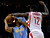 Houston Rockets' Patrick Beverley (12) tries to knock the ball away from Denver Nuggets' Andre Iguodala (9) in the first half of an NBA basketball game Wednesday, Jan. 23, 2013, in Houston. (AP Photo/Pat Sullivan)