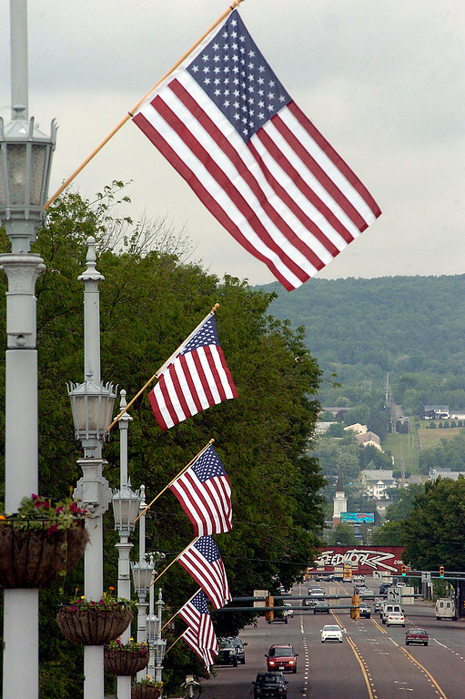 Description of . American flags fly across the Market Street Bridge in Wilkes-Barre, Pa., Thursday May 23, 2013. Wilkes-Barre City DPW workers installed the flags in conjucntion with veterans organizations and Memorial Day. (AP Photo/The Citizens\' Voice, Mark Moran)