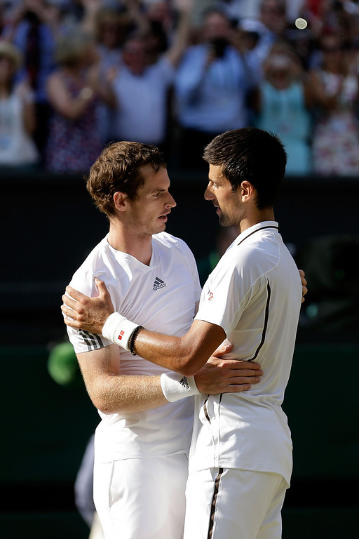 Description of . Andy Murray of Great Britain is congratulated by Novak Djokovic of Serbia following his victory in the Gentlemen's Singles Final match against Novak Djokovic of Serbia on day thirteen of the Wimbledon Lawn Tennis Championships at the All England Lawn Tennis and Croquet Club on July 7, 2013 in London, England.  (Photo by Anja Niedringhaus - Pool/Getty Images)