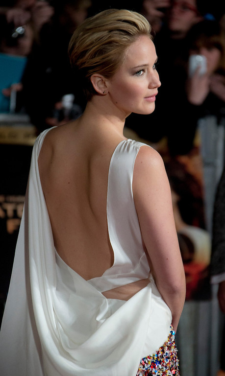 Description of . U.S actress Jennifer Lawrence arrives on the red carpet for the World Premiere of Hunger Games: Catching Fire, at a central London cinema, Monday, Nov. 11, 2013. (Photo by Joel Ryan/Invision/AP)