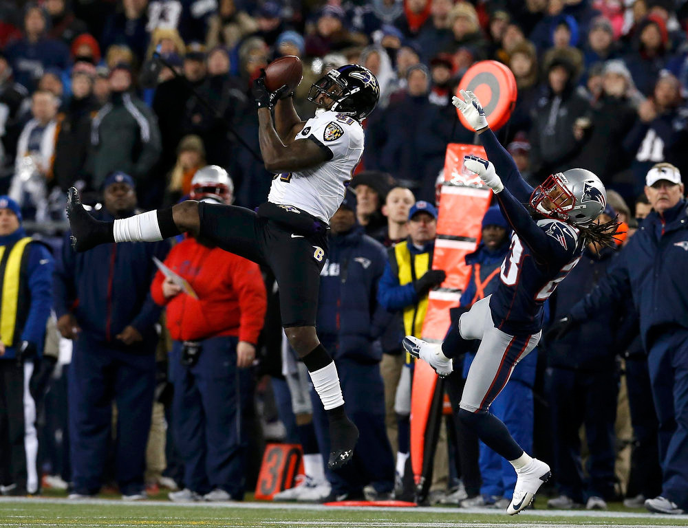 Description of . Baltimore Ravens wide receiver Anquan Boldin (81) makes a first down catch against New England Patriots defensive back Marquice Cole (23) in the third quarter of the NFL AFC Championship football game in Foxborough, Massachusetts, January 20, 2013. REUTERS/Jim Young