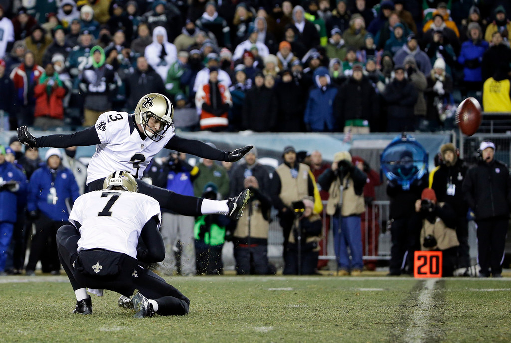 Description of . New Orleans Saints' Shayne Graham kicks the game-winning field goal in front of teammate Luke McCown during the second half of an NFL wild-card playoff football game against the Philadelphia Eagles, Saturday, Jan. 4, 2014, in Philadelphia. (AP Photo/Matt Rourke)