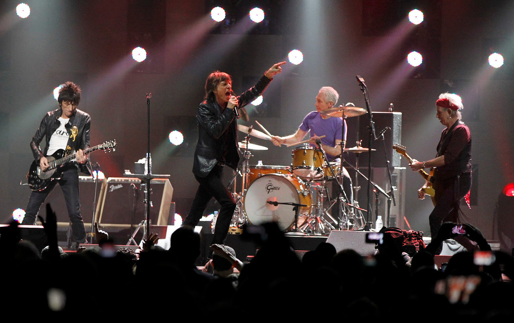 Description of . Ron Wood (L), Mick Jagger (2nd L), Charlie Watts and Keith Richards (R) of the Rolling Stones perform during the
