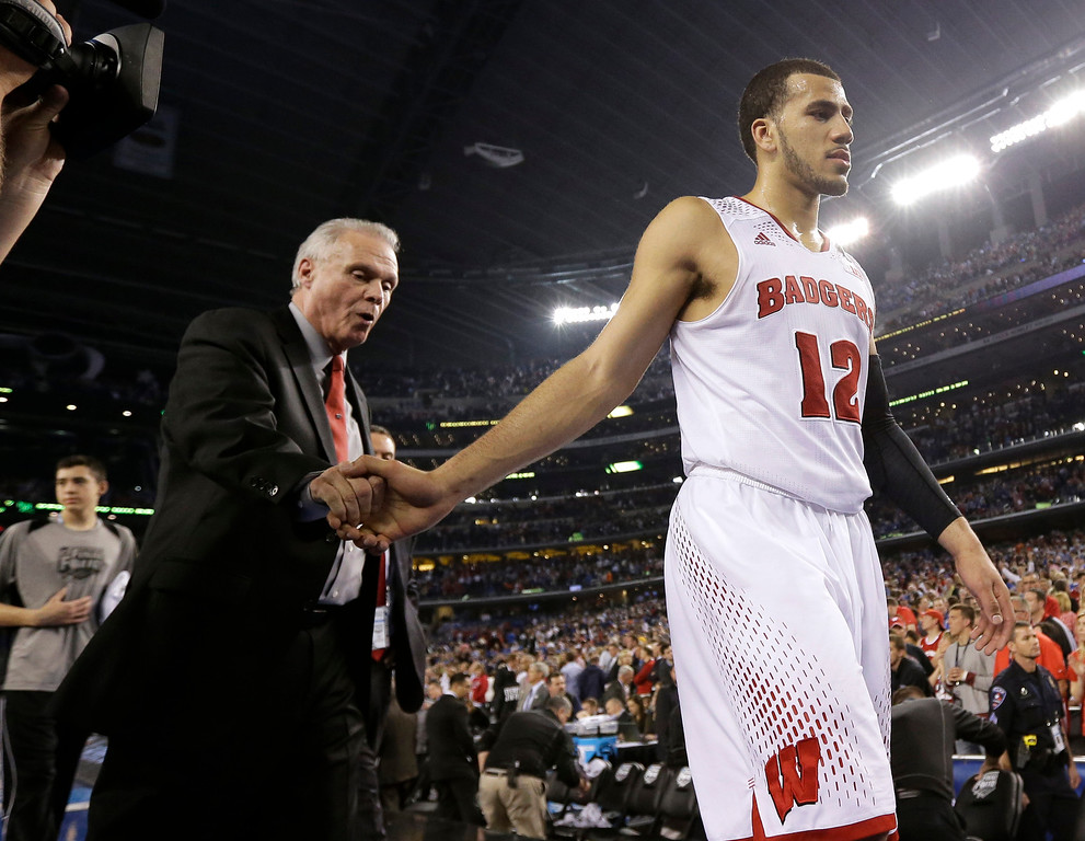 Description of . Wisconsin head coach Bo Ryan, left, and guard Traevon Jackson walk off the court after their 74-73 loss to Kentucky in an NCAA Final Four tournament college basketball semifinal game Saturday, April 5, 2014, in Arlington, Texas. (AP Photo/Eric Gay)
