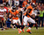 Denver Broncos wide receiver Trindon Holliday #11 runs the ball for a long punt return during the third quarter.  The Denver Broncos vs The Tampa Bay Buccaneers at Sports Authority Field Sunday December 2, 2012. John Leyba, The Denver Post