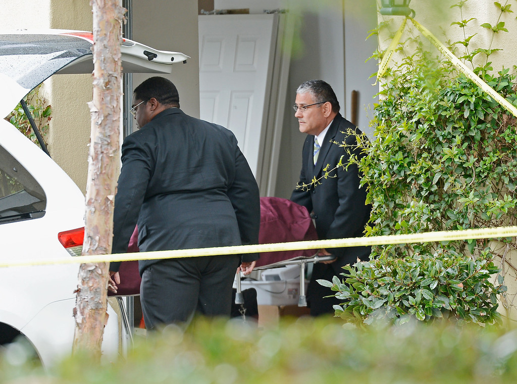 Description of . An Orange County Coroner picks a body of a victim from a house on February 19, 2013 in Ladera Ranch, California. .  (Photo by Kevork Djansezian/Getty Images)