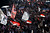 Egyptian demonstrators march from Moustafa Mahmoud mosque towards Tahrir Square in Cairo, Egypt, Friday, Jan. 25, 2013. Two years after Egypt's revolution began, the country's schism was on display Friday as the mainly liberal and secular opposition held rallies saying the goals of the pro-democracy uprising have not been met and denouncing Islamist President Mohammed Morsi. Banner in center shows an image of Egyptian feminist, Hoda Shaarawi who called for Egyptian women to remove the veil in 1922. (AP Photo/Ahmed Abd el Fattah)