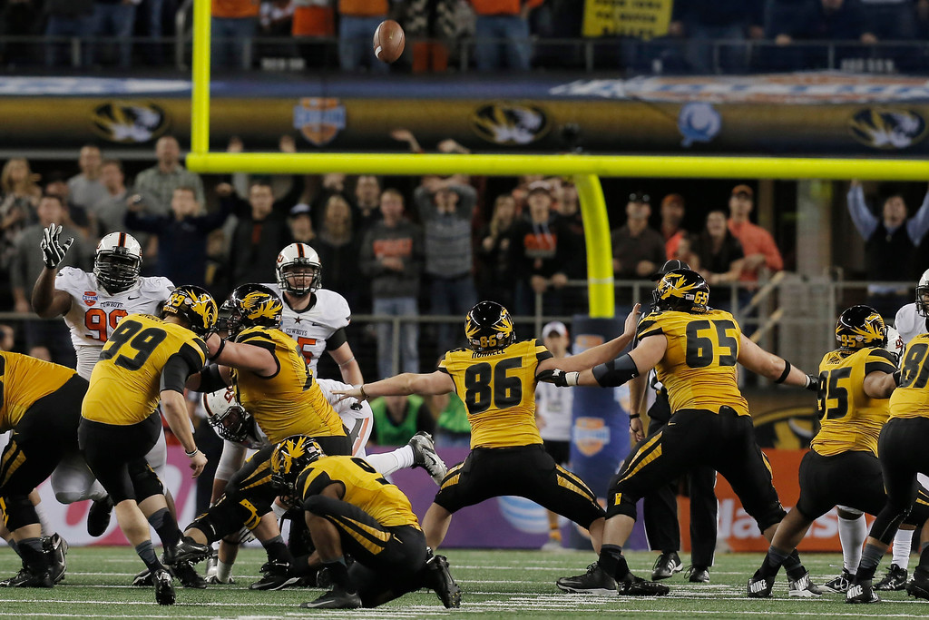 Description of . Missouri kicker Andrew Baggett kicks a field goal against Oklahoma State during the second half of the Cotton Bowl NCAA college football game, Friday, Jan. 3, 2014, in Arlington, Texas.  (AP Photo/Brandon Wade)
