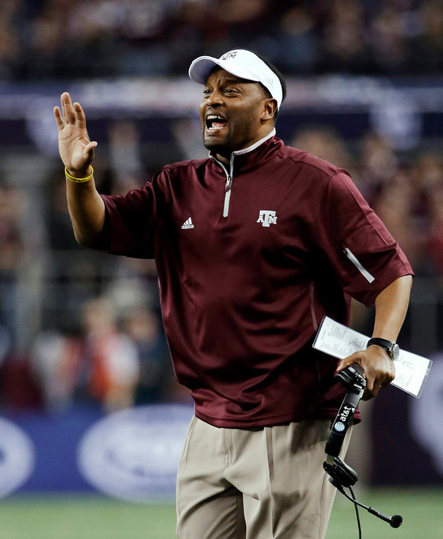 Description of . Texas A&M coach Kevin Sumlin calls out to his defense during the first half against Oklahoma in the Cotton Bowl NCAA college football game Friday, Jan. 4, 2013, in Arlington, Texas. (AP Photo/Tony Gutierrez)