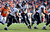 Baltimore Ravens quarterback Joe Flacco (5) hands off to Baltimore Ravens running back Ray Rice (27) early in the first quarter.  The Denver Broncos vs Baltimore Ravens AFC Divisional playoff game at Sports Authority Field Saturday January 12, 2013. (Photo by John Leyba,/The Denver Post)