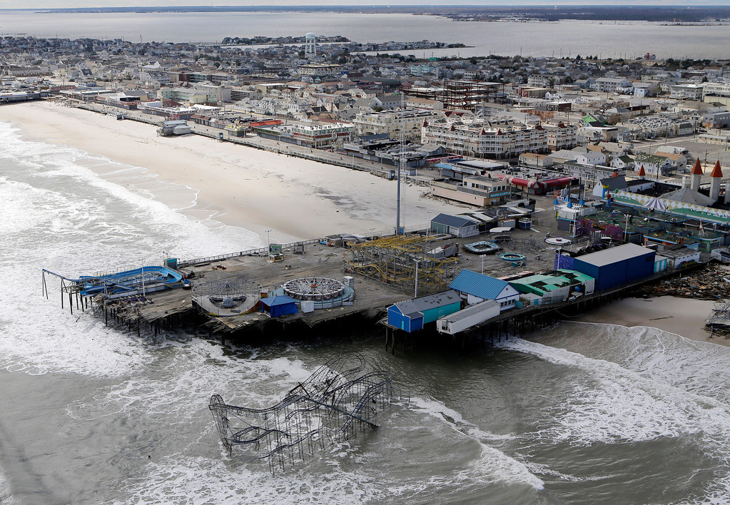 Description of . This Oct. 31, 2012 file aerial photo shows the damage to an amusement park in Seaside Heights, N.J., after Superstorm Sandy.  A massive fire raging for hours Thursday, Sept. 12, 2013, burned several blocks of a boardwalk and businesses in Seaside Heights, N.J. (AP Photo/Mike Groll, File)