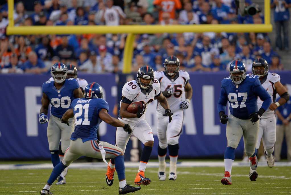 Description of . At the 2-minute warning in the first half tight end Julius Thomas (80) of the Denver Broncos gains 19 yards with a catch and run against the New York Giants at METLIFE Stadium. September 15, 2013 East Rutherford, NJ. (Photo By Joe Amon/The Denver Post)