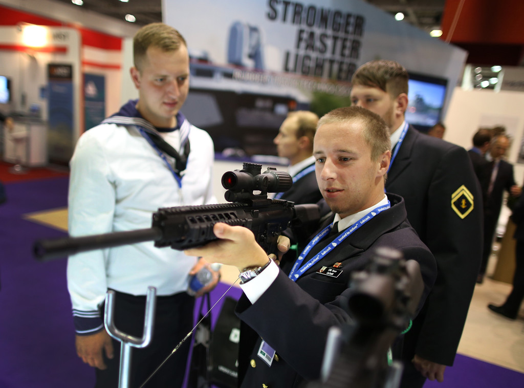 Description of . Sailors from the German Navy try out weapons at the Defense and Security Exhibition on September 10, 2013 in London, England.   (Photo by Peter Macdiarmid/Getty Images)