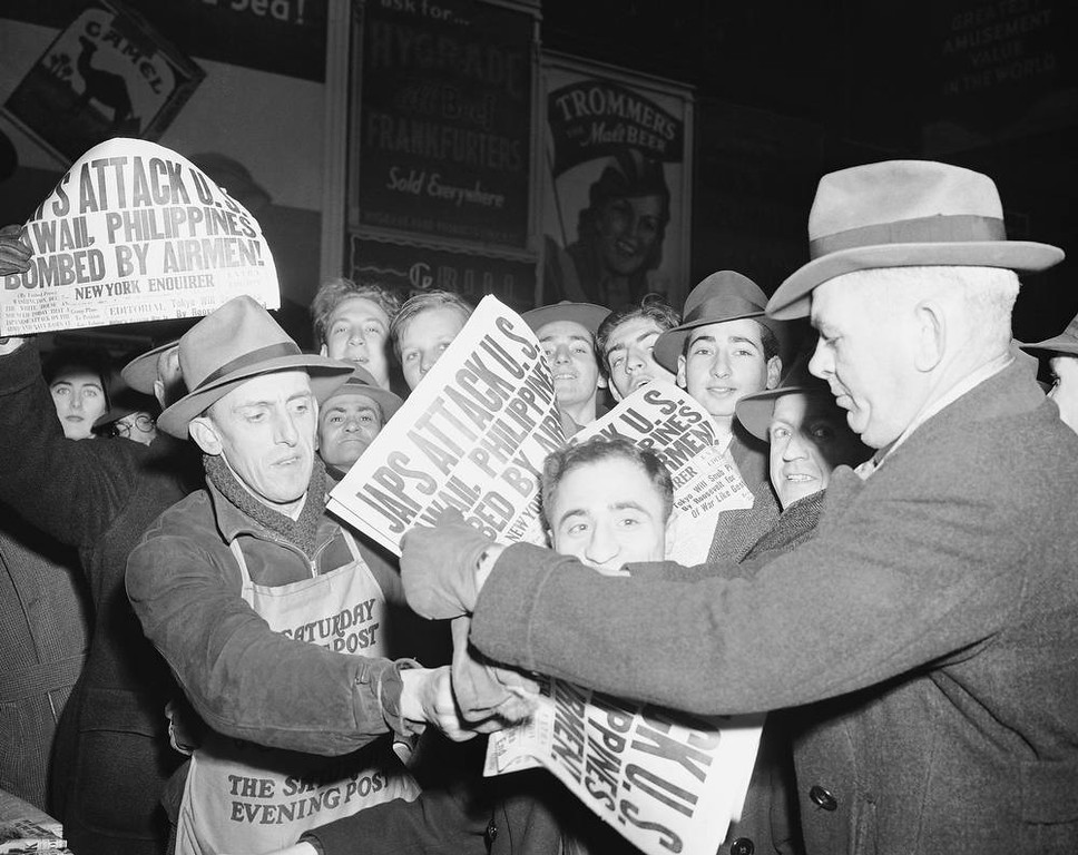 Description of . Selling papers  on Dec. 7, 1941 at Times Square in New York City, announcing that Japan has attacked U.S. bases in the Pacific. (AP Photo/Robert Kradin)
