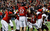 Seth Doege #7 of Texas Tech celebrates with his teammates after his a 4-yard touchdown in the second quarter against Minnesota during the Meineke Car Care of Texas Bowl at Reliant Stadium on December 28, 2012 in Houston, Texas.  (Photo by Scott Halleran/Getty Images)