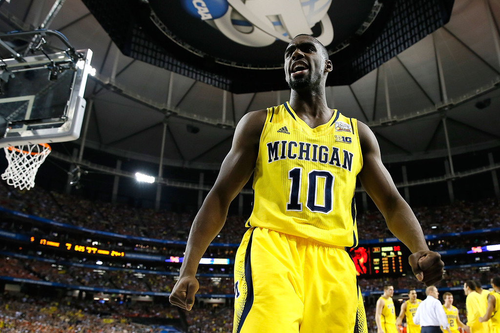 Description of . ATLANTA, GA - APRIL 06:  Tim Hardaway Jr. #10 of the Michigan Wolverines reacts in the first half against the Syracuse Orange during the 2013 NCAA Men's Final Four Semifinal at the Georgia Dome on April 6, 2013 in Atlanta, Georgia.  (Photo by Kevin C. Cox/Getty Images)