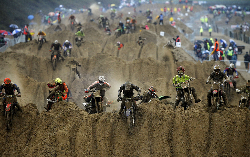 Description of . Riders reach the crest of a dune during the opening lap of the main race of the 2013 RHL Weston beach race in Weston-Super-Mare, southwest England, on October 13, 2013.  Beach racing is an offshoot of enduro and motocross racing. Riders on solo motorcycles and quad bikes compete on a course marked out on a beach, with man-made jumps and sand dunes being constructed to make the course tougher during the three-hour endurance race.   ADRIAN DENNIS/AFP/Getty Images