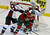 Colorado Avalanche's Erik Johnson, left, tries to push Minnesota Wild's Zach Parise out of the way as Avalanche goalie Semyon Varlamov of Russia defends the net in the first period of an NHL hockey game Saturday, Jan. 19, 2013 in St. Paul, Minn. Parise and Ryan Suter signed identical 13-year, $98 million contracts with the WIld.  (AP Photo/Jim Mone)