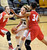 Jen Reese of CU, tries to move on Whitney Johnson of UNM during the first half of the December 29, 2012 game in Boulder.