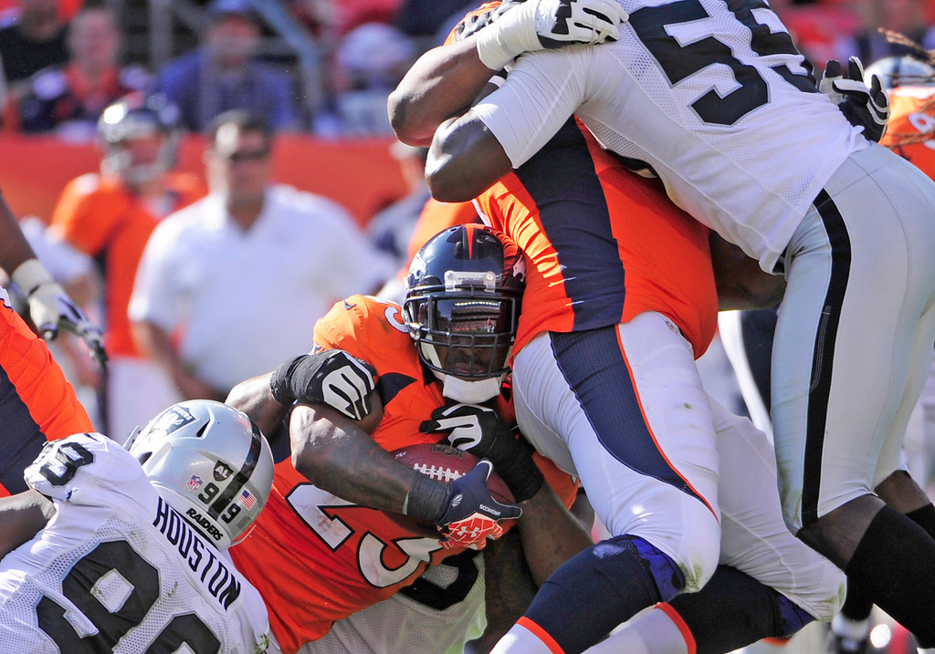 Description of . The Broncos Willis McGahee is tackled in the third quarter during the Denver Broncos game against the Oakland Raiders at Sports Authority Field at Mile High on Sunday, September 30, 2012. AAron Ontiveroz, The Denver Post