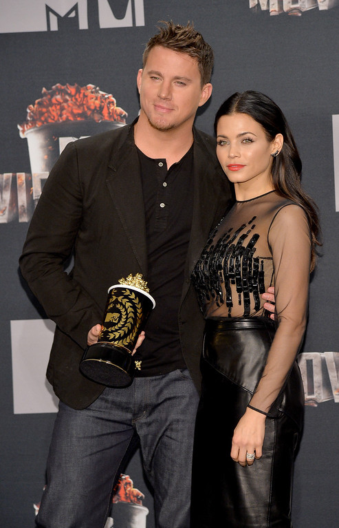 Description of . Actor Channing Tatum (L), recipient of the MTV Trailblazer Award, and actress Jenna Dewan Tatum pose in the press room during the 2014 MTV Movie Awards at Nokia Theatre L.A. Live on April 13, 2014 in Los Angeles, California.  (Photo by Michael Buckner/Getty Images)