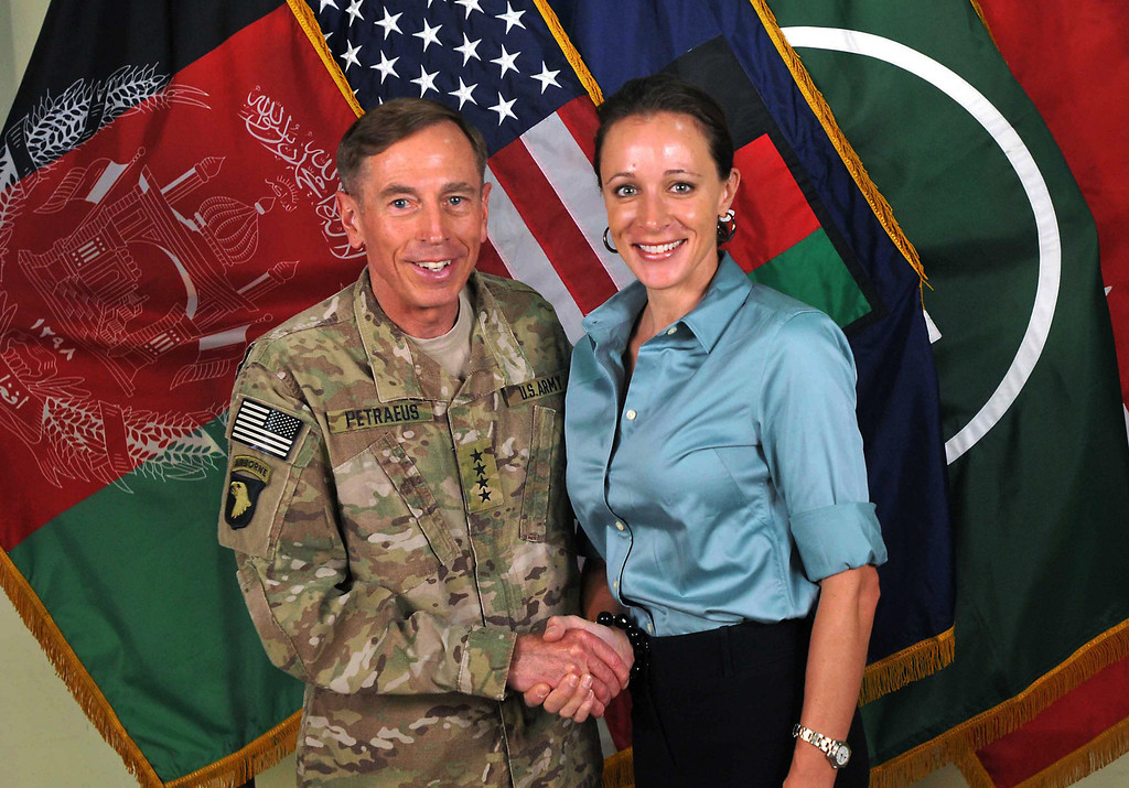 Description of . This July 13, 2011 file photo, made available on the International Security Assistance Force's Flickr website shows the former Commander of International Security Assistance Force and U.S. Forces-Afghanistan Gen. Davis Petraeus, left, shaking hands with Paula Broadwell, co-author of