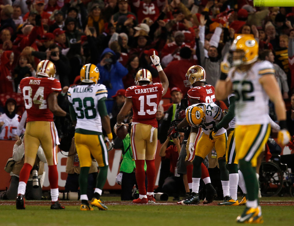 Description of . San Francisco 49ers wide receiver Michael Crabtree (15) celebrates his touchdown against the Green Bay Packers in the first quarter in the NFC Divisional Playoff on Saturday, January 12, 2013, at Candlestick Park in San Francisco, California. (Nhat V. Meyer/San Jose Mercury News)