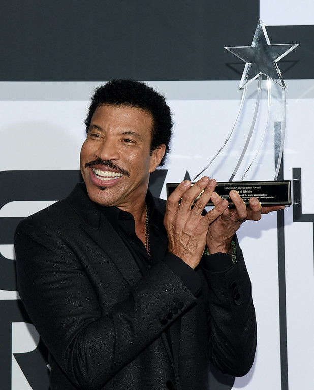 Description of . Singer Lionel Richie poses in the press room during the BET AWARDS '14 at Nokia Theatre L.A. LIVE on June 29, 2014 in Los Angeles, California.  (Photo by Michael Buckner/Getty Images for BET)