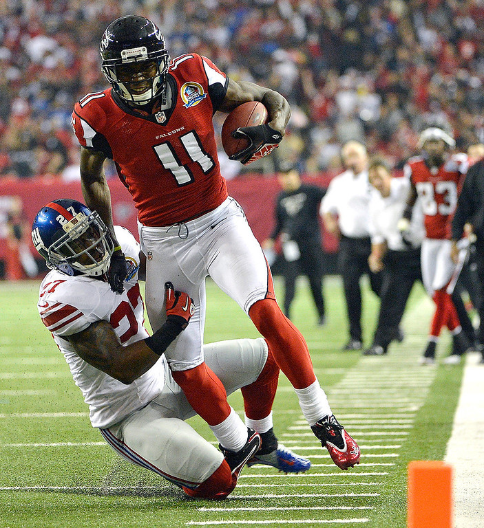 Description of . Atlanta Falcons wide receiver Julio Jones (11) runs as Atlanta Falcons cornerback Robert McClain (27) makes the tackle during the second half of an NFL football game on Sunday, Dec. 16, 2012, in Atlanta. (AP Photo/Rich Addicks)